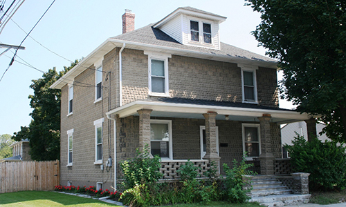 Classic Rock Face Rusticated Concrete Sears Block House American Foursquare Lattice Porch